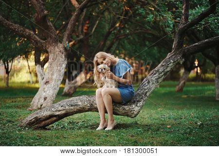 photo of young beautiful girl with pekingese