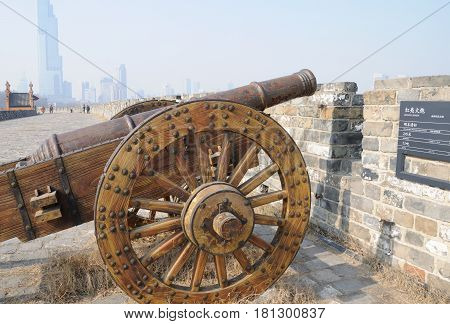 An old weathered cannon on the Nanjing city wall jiefang gate on an overcast day in Jiangsu province China.