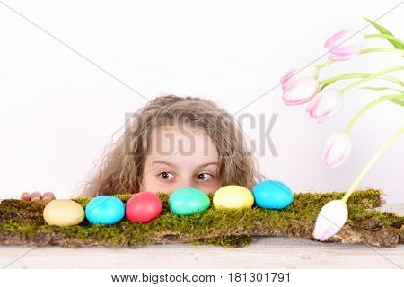 Happy Surprised Easter Girl With Colorful Eggs And Tulip Flowers