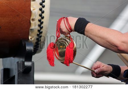 Closeup of a Taiko Drummer Playing Bells