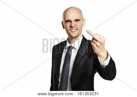 Furious young man shows fuck. Studio shot isolated on white background.