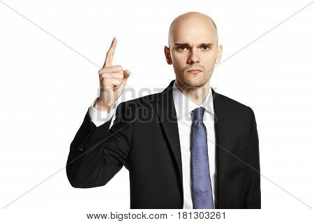 Portrait of young elegant man shows his finder. Isolated on white.
