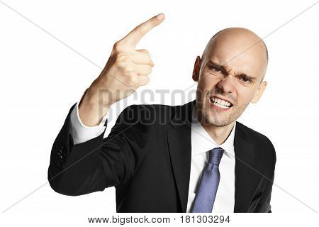Young aggressive businessman threatens his finger. Isolated on white background.