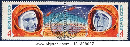 USSR - CIRCA 1963: Postage stamp printed in USSR shows portraits of cosmonauts Valery Bykovsky and Valentina Tereshkova, from the series