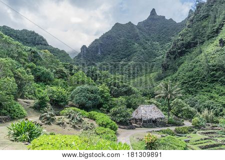 Primitive Paradise:grass hut, lush mountains, beautiful tropical garden, at the Limahuli Garden and Preserve-National Tropical Botanical Garden, in Ha'ena, Halele'a, Kauai, morning, March 24, 2017