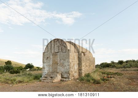 GRAAFF REINET SOUTH AFRICA - MARCH 23 2017: The historic gun powder magazine on a hill outside Graaff Reinet in the Eastern Cape Province