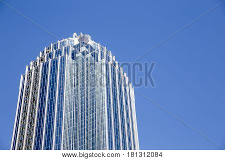 BOSTON, MA, USA - APRIL 9 2017: 111 Huntington Avenue, part of the Prudential Center complex. The R2-D2 Building. Boston skyscraper on blue sky background. Empty space for your text