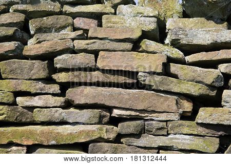 An old dry stone wall texture in the English countryside