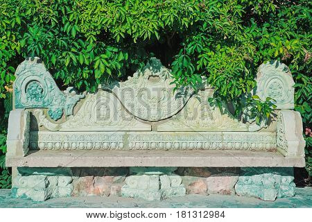 An Old Stone Bench in the Garden