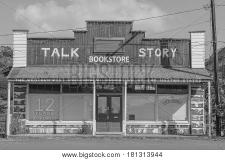 Talk Story: Talk Story Bookstore in an old building, in black and white, in the historic Hanapepe Town, Kauai, Hawaii, mid morning, March 28, 2017