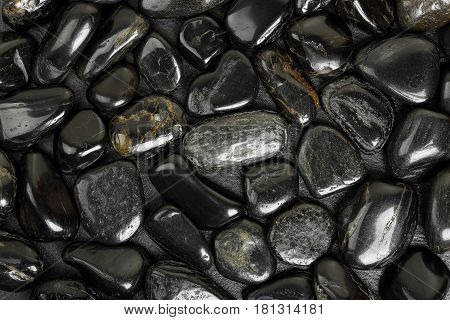 closeup of black shiny stones top view