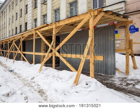 Murmansk Russia - March 14 2017: Temporary protected pavement near the reconstructed building