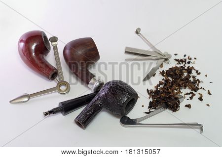 Set Of Tools For Smoking Pipes. Dismantled Wooden Smoking Pipes And Scattering Of Tobacco