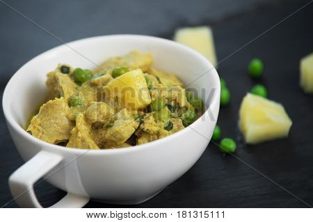 Pineapple, Pea And Pork Stew On Black Stone Background