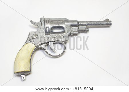 toy gun: revolver for firing percussion caps ornamented with white handle