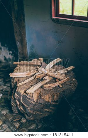 Wooden Block With Ax And Pieces Of Chopped Wood.