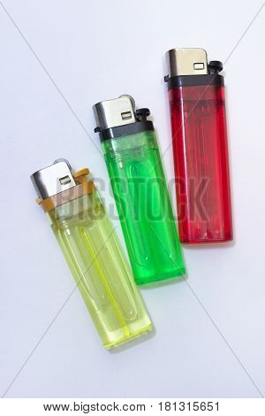 Multicolored disposable flint gas lighters. Reds greens yellows