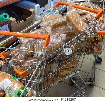 Murmansk Russia - March 16 2017: Trolleys with fresh bread in the supermarket