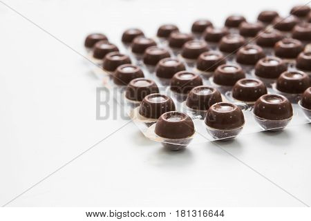 manufacturing of handcrafted chocolate candies in daylight
