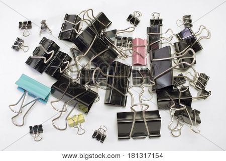 oodles of metal binder clips for paper different sizes and colors