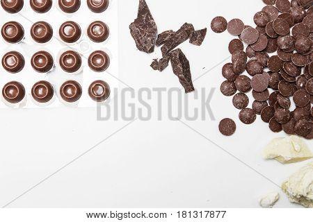 milk chocolate pieces preform candies in daylight