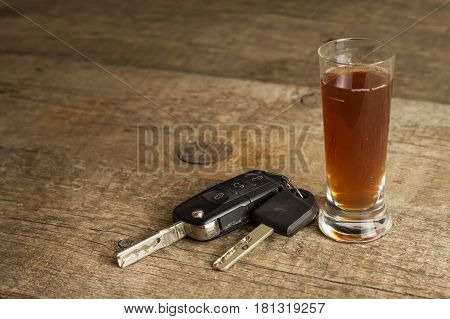 Alcohol and driving. Danger on the roads. Alcoholic behind the wheel. Car keys on the bar