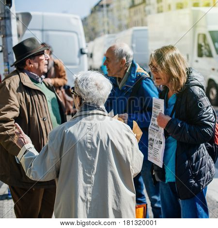 STRASBOURG FRANCE - APR 8 2017: Political agitation at French market for the upcoming French presidential election 2017 - political discussion at French market