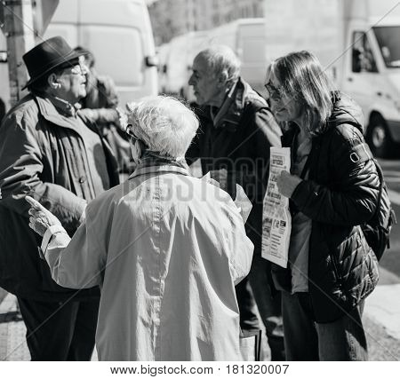 STRASBOURG FRANCE - APR 8 2017: Black and white image of political agitation at French market for the upcoming French presidential election 2017 - political discussion at French market