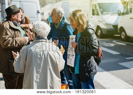 STRASBOURG FRANCE - APR 8 2017: Political agitation at French market for the upcoming French presidential election 2017 - seniors discussion about upcoming elections