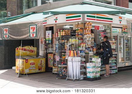 SINGAPORE - MAR 21 2017 : Tourist buy food and drink in convenience store at 7-Eleven shop in front of the street on Orchard Road Singapore.