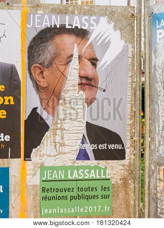 STRASBOURG FRANCE - APR 12 2017: Official campaign posters of Jean Lassalle political party leader of Resistons ones of the eleven candidates running in the 2017 French presidential election