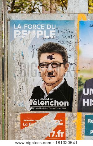 STRASBOURG FRANCE - APR 12 2017: Official campaign posters of Jean-Luc Melenchon political party leader of La France insoumise ones of the eleven candidates running in the 2017 French presidential election