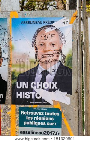 STRASBOURG FRANCE - APR 12 2017: Official campaign posters of Francois Asselineau political party leader of Union populaire republicaine (UPR) ones of the eleven candidates running in the 2017 French presidential election