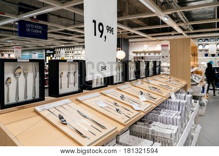 PARIS FRANCE - APR 10 2017: Diverse tableware and cutlery solutions for sale inside IKEA furniture hypermarket store