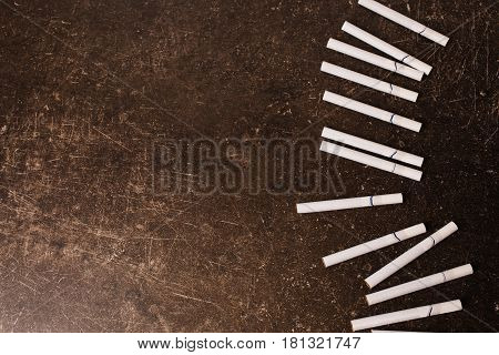 Cigarettes on a dark marble background. Bad habit. Health care. Cigarettes concept. Flat lay Cigarettes