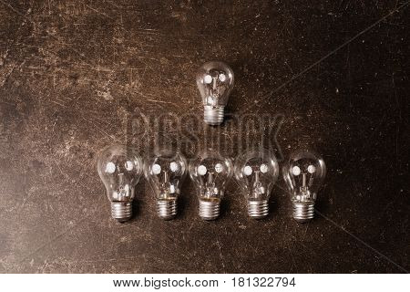 Light bulb on a dark marble background. To save energy. Eco concept. Object on a dark background. Transparent object. Conceptual object. The objects are on the table. Object on marble