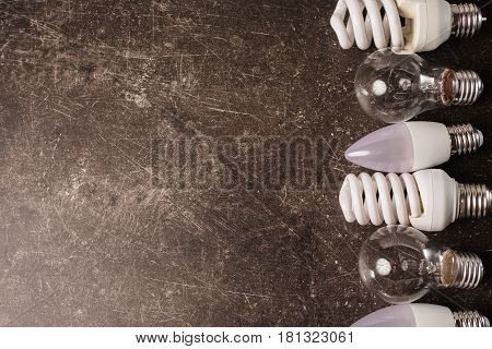 LED bulb incandescent lamp fluorescent lamp on a dark marble background. To save energy. Eco lamp concept