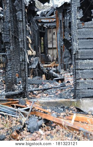 House fire burned to the ground caused by overheated wiring.