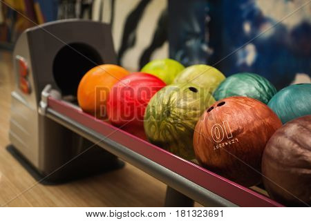 Colored bowling balls. Games and entertainment with friends. Sports equipment. Colored balls. Multicolored balls.