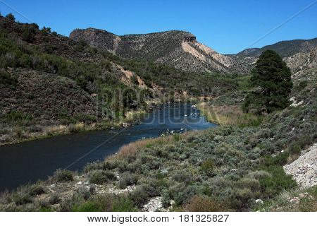 Rio Grande River flows through the arid landscape near Taos, New Mexico