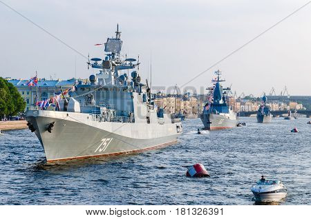SAINT PETERSBURG, RUSSIA - July 27, 2014:  Frigate Admiral Essen moored Russia on the Neva river for the parade in honor of Navy Day in St. Petersburg. 27 July 2016.