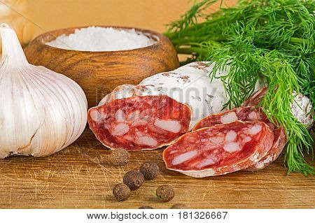 Sliced Salame On Cutting Board, With Dill, Pepper, Salt