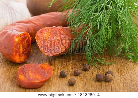 Chorizo Sausage Sliced On Wood Chopping Board