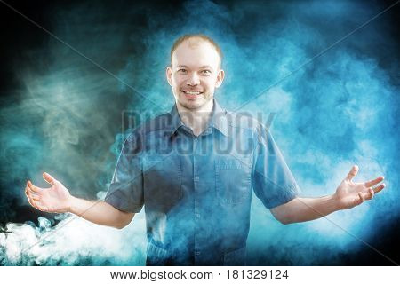 young doctor smilling in the smoke. Halloween