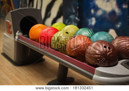 Colored bowling balls. Games and entertainment with friends. Sports equipment. Bowling concept
