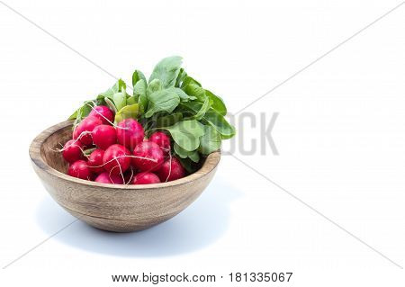 Fresh Radish With Green Leaves In A Natural Wood Bowl Isolated In White Background