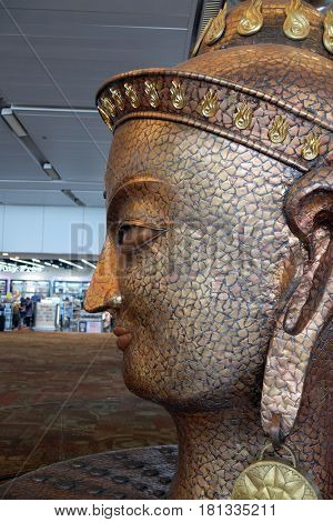 DELHI, INDIA - FEBRUARY 19: Surya, the resplendent one by Satish Gupta, the golden statue in Airport of Delhi on February 19, 2016. Indira Gandhi International Airport is the 32th busiest in the world