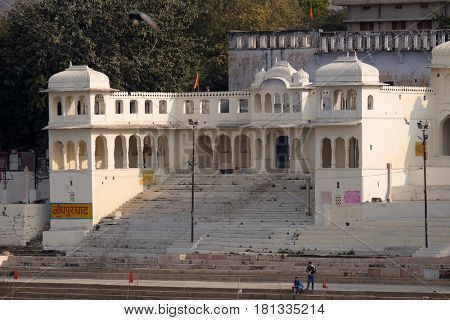 PUSHKAR, INDIA - FEBRUARY 17: Temples, buildings and ghats at the holy Pushkar Lake, Pushkar Sarovara, Hindu pilgrimage site, Rajasthan, India on February 17, 2016.