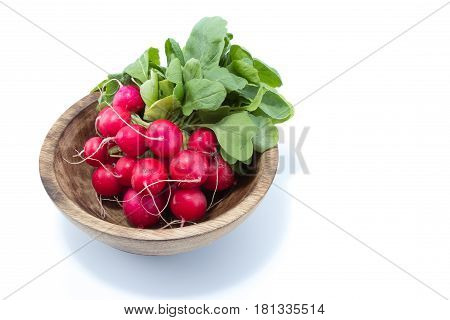 Radish With Green Leaves In A Natural Wood Bowl Isolated In White Background - View From The Top