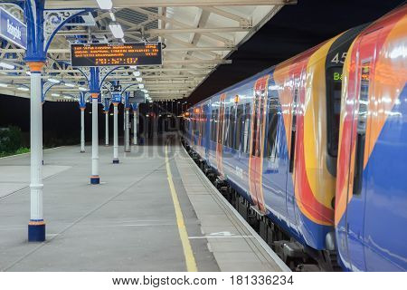 Basimngstoke, UK. 11th April 2017. A South West Trains Desiro unit class 450 electric multiple unit is at Basingstoke Station awaiting departure of a stopping service to London Waterloo.